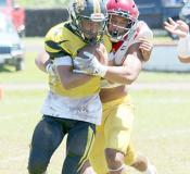 Tafuna Warriors Francisco Mauigoa and a Nuuuli Wildcat ball carrier