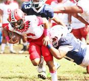 A Samoana defender brings down the Vikings ball carrier