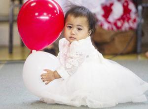Little girl in her White Sunday finery