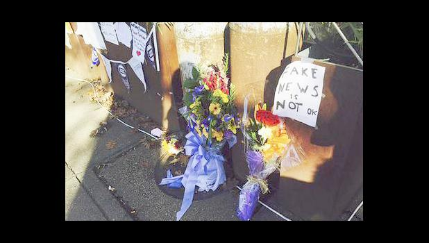 - In this Friday Dec. 9, 2016 file photo, flowers and notes left by well-wishers are displayed outside Comet Ping Pong, the pizza restaurant in Washington. There's at least a slice of good news for a pizza restaurant in the nation's capital that has been the target of fake news stories linking it to a child sex trafficking ring. In almost a week since an armed man arrived at Comet Ping Pong to investigate the conspiracy, neighbors and patrons have responded by bringing homemade signs, flowers and their pizz