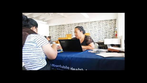 Cinder Sonis, right, an advocate with Legal Aid Society of Hawaii, helped a customer enroll in an Affordable Care Act health insurance plan on Monday, Jan. 30, 2017 in Honolulu. Faced with uncertainty about the federal health care law, Hawaii lawmakers are introducing bills to bring what they believe are the best parts of the Affordable Care Act into state law. (AP Photo/Cathy Bussewitz)