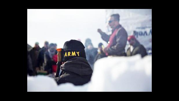 An Army veteran attends a briefing for fellow veterans at the Oceti Sakowin camp where people have gathered to protest the Dakota Access oil pipeline in Cannon Ball, N.D., Saturday, Dec. 3, 2016. (AP Photo/David Goldman)