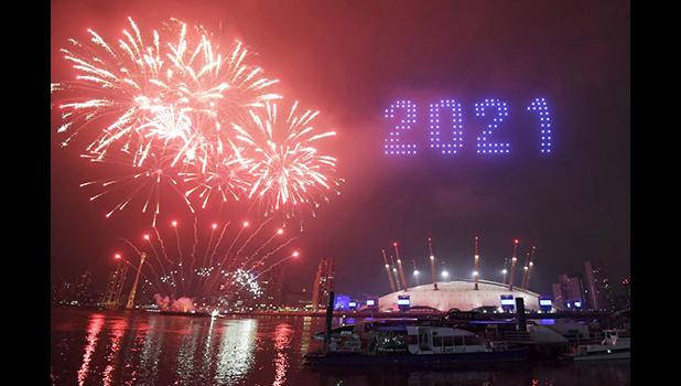 Fireworks and drones illuminate the night sky over London