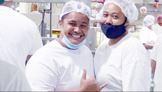 Two woman who work for StarKist Samoa
