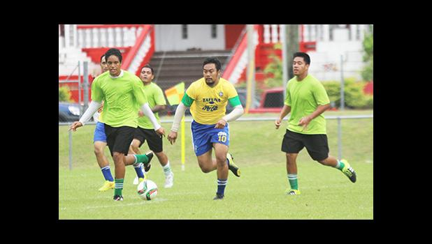 Peter Alosio (middle) of the Tafuna Jets dribbles against Lion Heart defenders Paul Collins (left) and Frank Hunt (right) in a men's game on Match Day 5 of the 2016 FFAS National League on Saturday, Sept. 17, 2016 at Pago Park Soccer Stadium. 