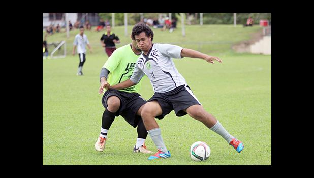 Tea Siatu'u of Utulei Youth in action against Ilaoa & To'omata opponent Shane Ah Hing in a men's game on Match Day 5 of the 2016 FFAS National League on Saturday, Sept. 17, 2016 at Pago Park Soccer Stadium.