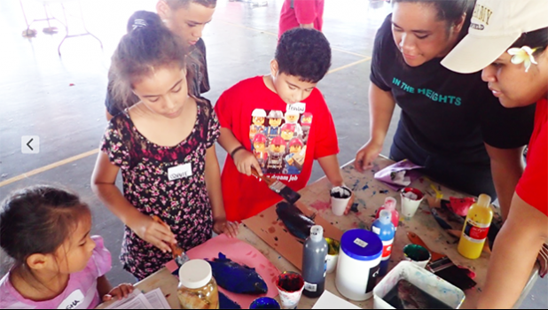 ASCC Marine Science student interns Claudia Thompson and Naomi Matagi teach local youth about fish anatomy and ecology through fish prints at the recent STEM Summit at Samoana High School.  [Courtesy Photo]