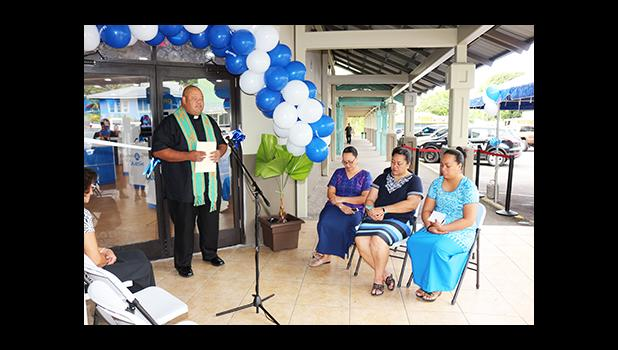 """Father Vaiula Kolio blessing the newly renovated Bluesky Communications store at the Laufou Shopping Center, yesterday morning. The inside of the store was 'blessed' with Holy Water —which the Catholic priest said, """"With the intention that all will be good in the name of our Lord.""""  [photo: TG]"""