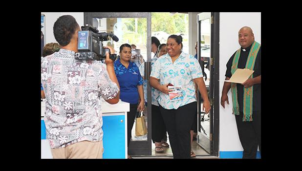 Huge smiles on the faces of Bluesky Communications employees as they were officially welcomed into their newly renovated store – which re-opened yesterday morning at the Laufou Shopping Center. [photo: TG]