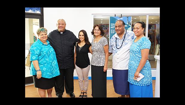 Bluesky Communications Country Manager of American Samoa Filifotu Va'ai-Tinitali (far right) posing with some of her colleagues, as well as Father Vaiula Kolio – just after the dedication ceremony of Bluesky Communications' newly renovated store, inside the Laufou Shopping Center, yesterday morning. [photo: TG]