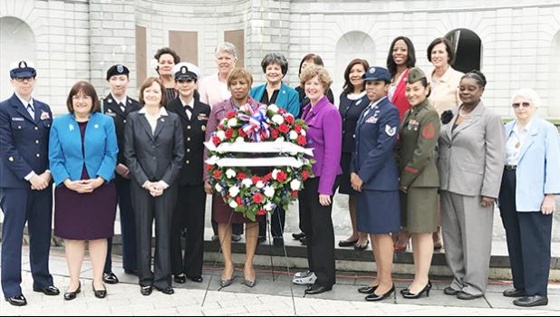 Congresswoman Amata with her fellow Congressional Caucus for Women's Issues colleagues, and the honorees  from the Navy, Air Force, Marines, Army, and Coast Guard stand before the Women's Memorial at Arlington National Cemetery. [courtesy photo]