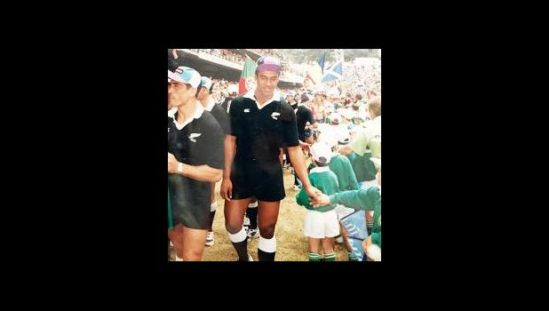 Jonah Lomu and his New Zealand Rugby Seven's teammates greeted youth teams during opening ceremonies at the 20th Anniversary 1994 Hong Kong 7s. [Photo Copyright Barry Markowitz, 1994]