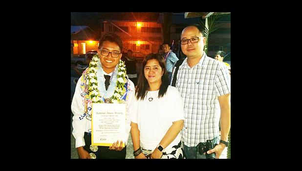 Proud parents Mr. and Mrs. Danny and Jenny DeLara with their son Hewlitt, one of the newly inducted members of Manumalo Academy's National Honor Society. [Photo: Blue Chen-Fruean]
