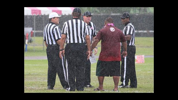 A frustrated Kolose Ili, the Warriors Head Coach arguing with the official on a call – Nu'uuli's fourth down which resulted in a fumble, giving the Wildcats the fortunate first down conversion that allowed them the opening touchdown of the game, late in the first quarter of play. [photo: TG]