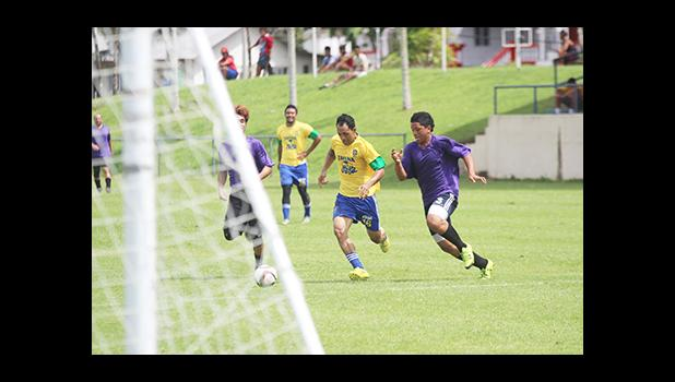 Tuaoloina 'Stein' Solofa (left) of the Tafuna Jets in an attacking run against Faiai Ioapo of PanSa during a men's game on Match Day 4 of the 2016 FFAS National League on Saturday, Sept. 10, at Pago Park Soccer Stadium.  [FFAS MEDIA/Brian Vitolio]