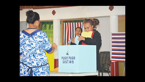 A voter puts a ballot into the ballot box at the Pago Pago village polling station on Election Day. [photo: AF]