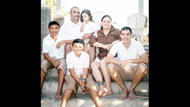 """US Navy Yeoman Seaman Recruit Faafetaiilealii """"Tai"""" Raison (far right) with his three brothers and parents Josephine and Melvin Ae. Tai was recently recognized as PCU Portland LPD 27s Sailor of the Week. See story for full details.  [photo: courtesy]"""