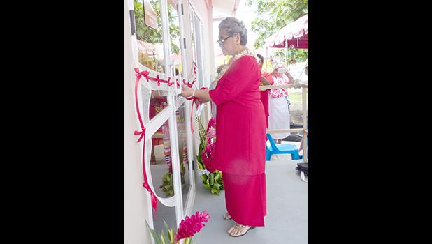 First lady Cynthia Malala Moliga cuts the ribbon during yesterday's official dedication and opening of the new building in Tafuna for the Red Cross of American Samoa. See story inside. [photo: Leua Aiono Frost]