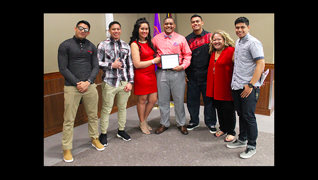 Family and Friends of Ricardo Gonzales (left to right) Tanielu Matautia, Salvation Lee, Caroline EJT Schuster, Justin Asaeli, Omeka Siataga, Loha Schuster, with , Ricardo Gonzales (center), after he received the Top Scholar Award in Criminal Justice from Missouri Valley College, last week. [courtesy photo]