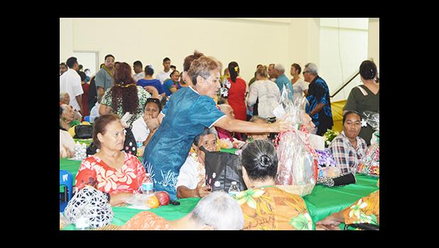 ducation Department deputy director Faauifono Vaitautolu, giving out gift baskets to senior citizens at yesterday's Senior Citizens Christmas Program 2016, held at the Pago Pago Youth Center. The event is an annual celebration hosted by the Lolo Administration.   [photo: AF]