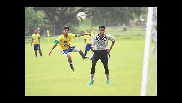 Pouono Samuelu of the Tafuna Jets takes a shot at goal while Utulei Youth's Tokoita Vaieli looks on in a men's game on Match Day 12 of the ongoing, 2016 FFAS National League on Saturday, Nov. 12, at Pago Park Soccer Stadium.  [FFAS MEDIA/Brian Vitolio]