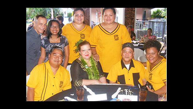 2017 Territorial Teacher of the Year, Dana Love-Ili (2nd from left siting), with her colleagues and friends from Nu'uuli Vocational Technical High School, at last Friday evening's TTOY celebration at the Tradewinds Hotel Pavilion.  [photo: FS]