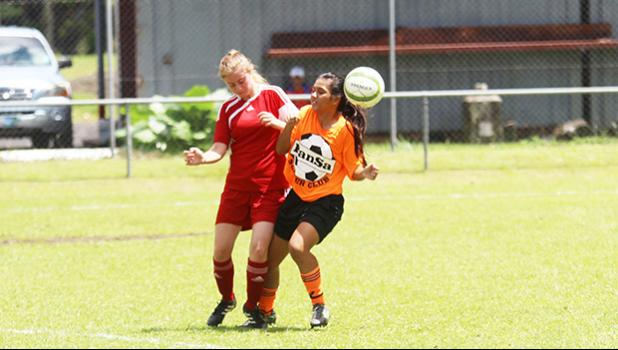 A Vaiala Tongan player, left, and PanSa opponent battle for possession of the ball during a women's Match Day 2 game of the 2017 National League on Saturday, Sept. 9, 2017 at Pago Park Soccer Stadium. Vaiala Tongan won 2-1.[FFAS MEDIA/Brian Vitolio]