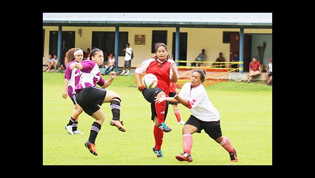 Tafuna Jets captain Beulah Oney (middle) defends against PanSa's Titiula Manuma (left) during the women's Cup challenge game on Match Day 5 of the 2016 FFAS National League on Saturday, Sept. 17, at Pago Park Soccer Stadium. [FFAS MEDIA/Brian Vitolio]