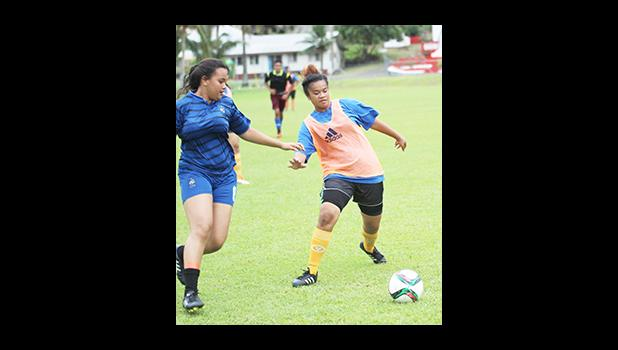 Women's soccer action between a Green Bay (left) and Royal Puma opponents on Match Day 5 of the 2016 FFAS National League on Saturday, Sept. 17, at Pago Park Soccer Stadium. [FFAS MEDIA/Brian Vitolio]