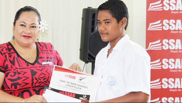 Samoa Stationery and Books owner and Chief Executive Officer Fiti Leung Wai during SSAB's Ambassador Scholarship program that is part of their annual Back to School Campaign two weeks ago. She's pictured here during the ceremony held at their SSAB conference room in Apia with one of the scholarship recipients.  [Courtesy Photo]
