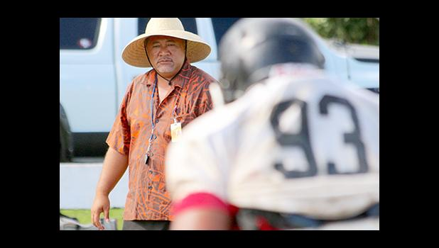 Nu'uuli Wildcats Head Coach Tupa'i Rod Atafua encouraging his players – during the hardest part of any football team's practice — conditioning.  [photo: TG]