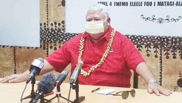 Samoa Prime Minister Tuilaepa Sailele Malielegaoi speaking to reporters
