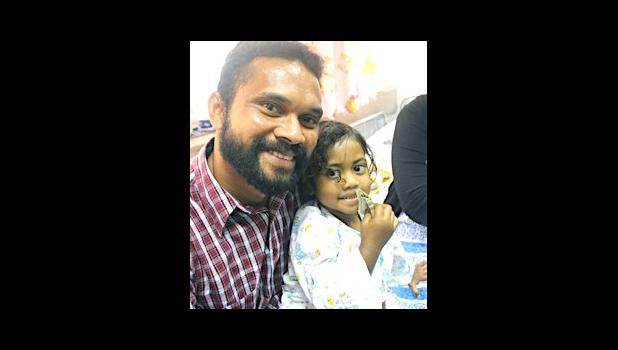 Three-year old Abigail Gaunavou and her father