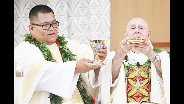 Deacon Ese'ese Tui assists Bishop Larry Silva