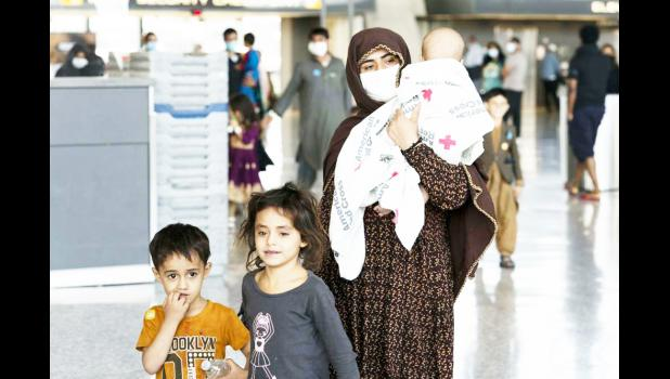Afghan mother with her children arrive in the U.S.