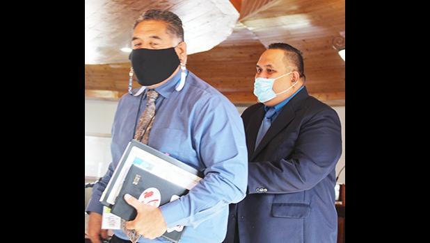 Christopher King (front) and Attorney General Fainu'ulelei Falefatu Alailima-Utu