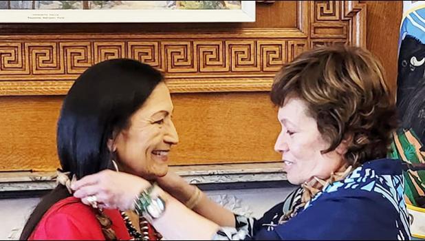 Congresswoman Uifa'atali Amata presents an ula fala to her former House colleague, new Secretary of the Interior Deb Haaland