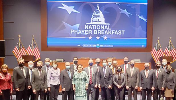 Amata and other Representatives and Senators at the National Prayer Breakfast.