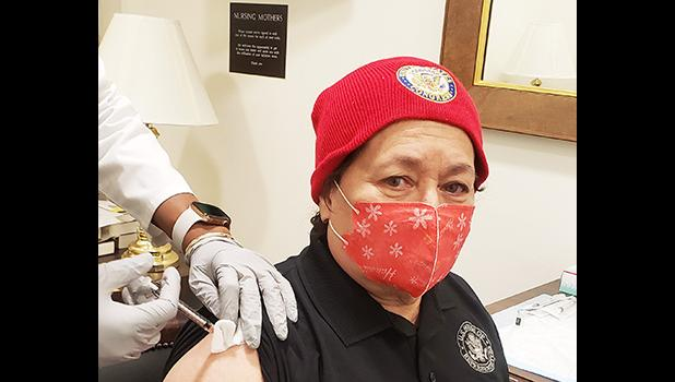 Amata getting vaccinated while wearing a mask