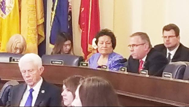Congresswoman Amata seated by Ranking Member Bost