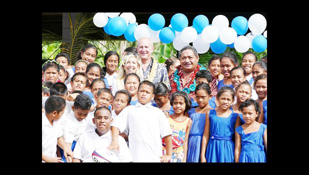 WORK IN SAMOA: Ambassador Mark Gilbert and his wife Nancy Gilbert with Samoan students during one of his recent visits. [Samoa Observer]