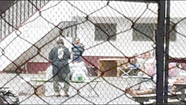 People inside an ASCC coronavirus quarantine site.