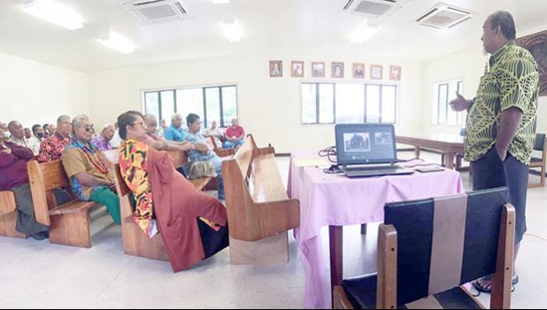 Pulenuu watching presentation