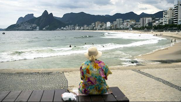 An elderly woman watches Arpoador beach in Rio de Janeiro, Brazil, March 17, 2020