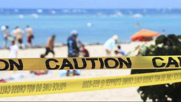 Waikiki beach with yellow caution tape