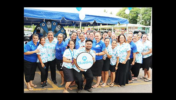 Bluesky Communications employees pose for a group photo, just before the dedication ceremony to open their newly renovated store at the Laufou Shopping Center, yesterday morning.  [photo: TG]