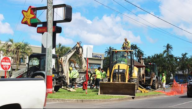 Heavy equipment removing bus stop in front of Laufou