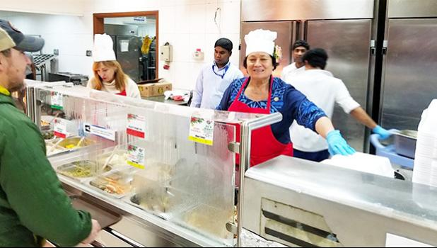 Amata serving food to the troops in Kuwait over the Christmas holiday