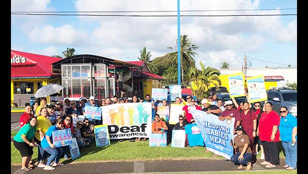 Deaf Awareness Month wave in front of McDonald's