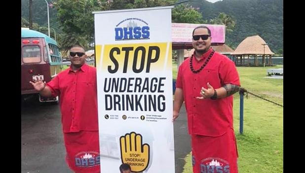 DHSS staff with prevent underage drinking sign